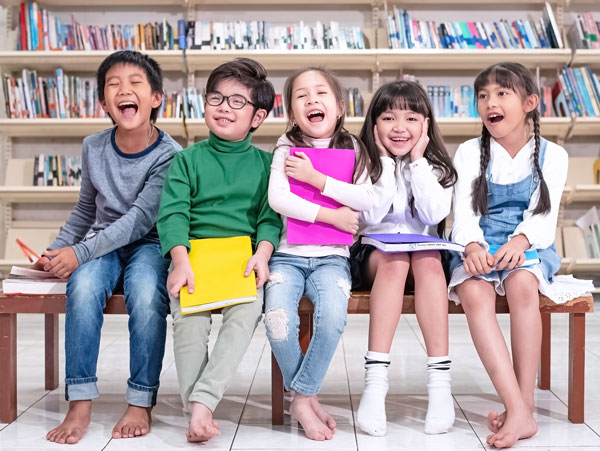 five smart children sitting wooden chair with happy feeling enjoy with their class school